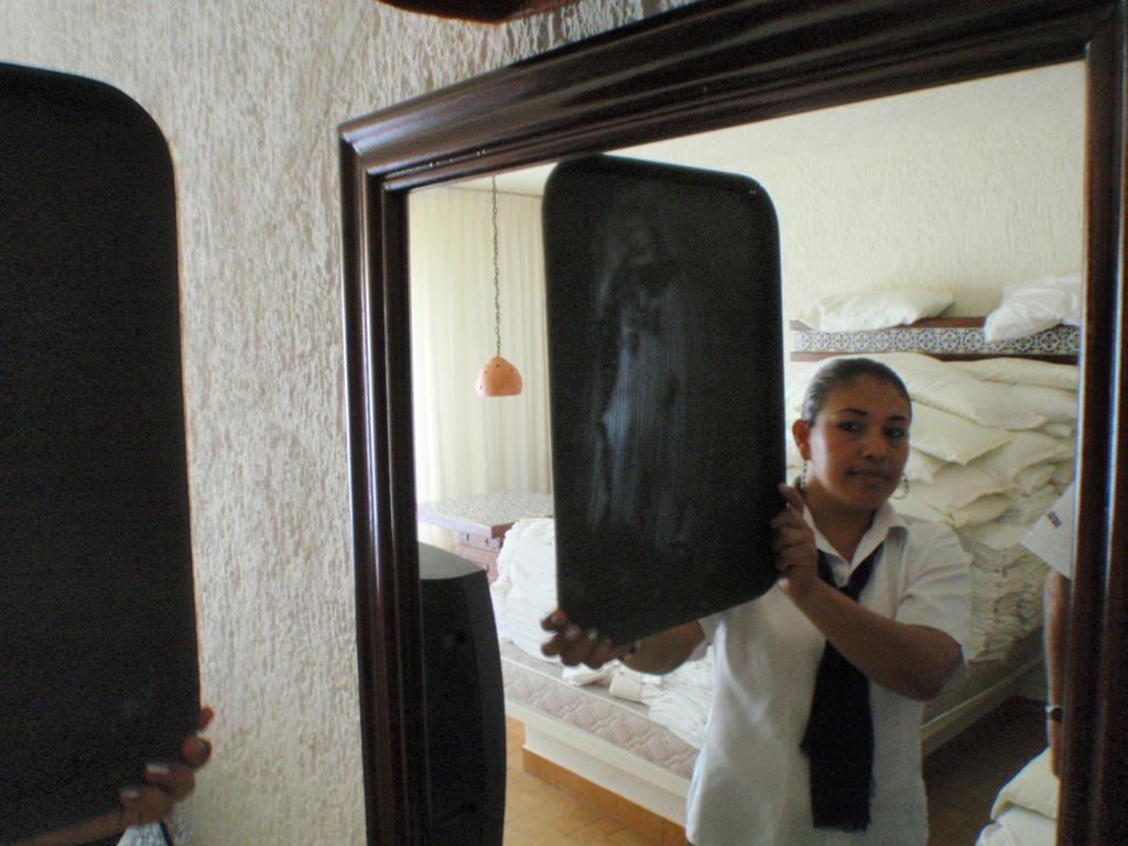 Virgen en el espejo